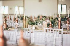 The silver chairs faded with the white table linnen making the copper stand out