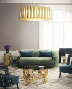 Green, blue, gold furnishings with soft toned grey/dusty lavender walls and rug.