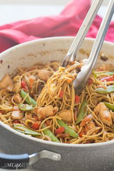 An easy, one pot version of Chicken Chow Mein - loaded with peppers, cabbage, peas and carrots it's an easy, healthy meal the whole family loves! Say no to takeout ;) Includes step by step recipe video. | one pot pasta | one pot meal | one pan meal | easy dinner recipe | healthy dinner recipe | family friendly | takeout | Chinese | Asian
