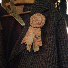 brooch on tweed jacket