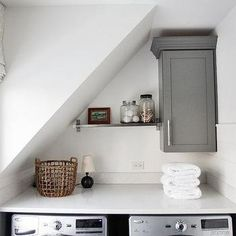 Small Laundry Room with Washer and Dryer Under Sloped Ceiling