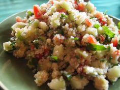 Jennifer Aniston's Quinoa Salad  1/2 cup quinoa  1 cup water  1 bunch flat leaf parsley, washed and chopped (thick stems removed)  4 Persian cucumbers, peeled, seeded, and diced  2 medium tomatoes, diced  1 ripe, but slightly firm avocado, diced  2-3 tbs. extra-virgin olive oil  salt and pepper to taste