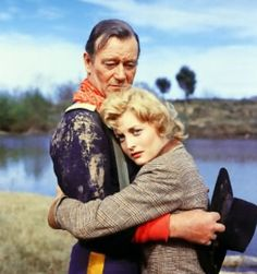 THE HORSE SOLDIERS (1958) - John Wayne & Constance Towers - Directed by John Ford - United Artists - Publicity Still.