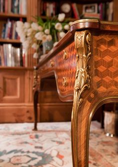 Up close and personal with this beautiful 19th-century French Rosewood desk. - Traditional Home ® / Photo:  Mark Edward Harris and Michael McCreary / Design: Timothy Corrigan