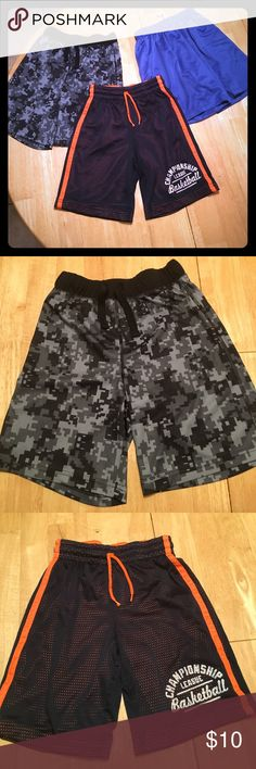 Bundle of 3 boys basketball shorts All in very good condition. 2 are childrens place. The other is A4. All drawstring waists. Royal blue. Black and grey pattern and Navy over orange. All comfortable and perfect for summer Bottoms Shorts