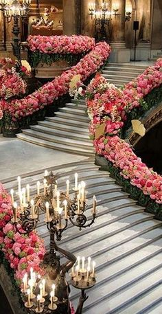 These floral covered staircases... sigh... dream wedding material!
