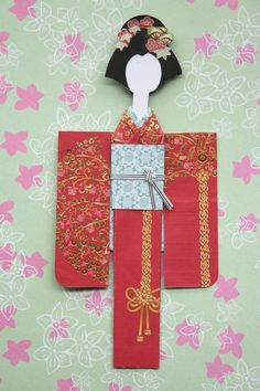 Mikano Yuri: Red kimono paper doll with shochikubai kanzashi (front)