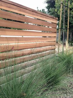 Wooden slats with ornamental grass.