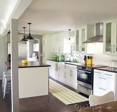 Great kitchen, white cabinets, dark counters. | IHeart Organizing: Reader Space: Beautiful Inside & Out