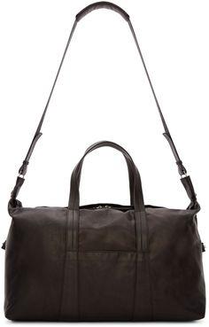 maison margiela paperweight duffle bag https://www.ssense.com/en-us/men/product/maison-margiela/black-paperweight-duffle-bag/1192993
