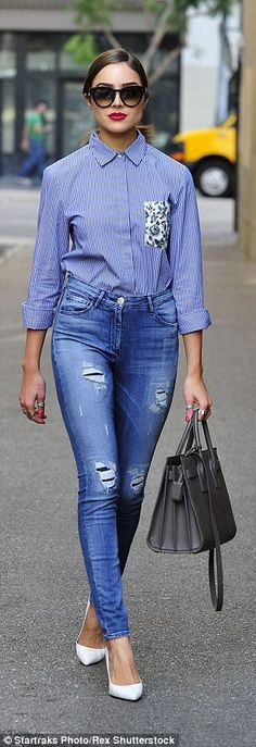 Baby blues: For her wander around Hollywood, Olivia wore a pair of tight distressed denims with a blue stripped shirt featuring a floral pocket