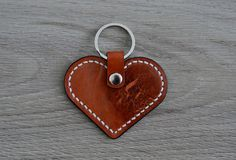 Hey, I found this really awesome Etsy listing at https://www.etsy.com/listing/231825411/leather-heart-keychain-brown-and-white