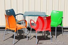 Photo about Colorful chairs outside in sunlight. Image of green, modern, chair - 77664506 Colorful Chairs, Photo Colour, Vectors, The Outsiders, Objects, Sign, Stock Photos, Green, Summer