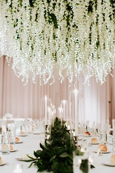 Most Magical Hanging Floral Installation With Fairy Lights ~ so beautiful! Stems Floral Design + Production intertwined fairy lights among 100 square feet of hanging white wisteria which was suspended above a long table. Wedding Table Centerpieces, Reception Decorations, Event Decor, Table Decorations, Wedding Tables, Diy Decoration, Wedding Receptions, Wisteria Wedding, Wedding Flowers