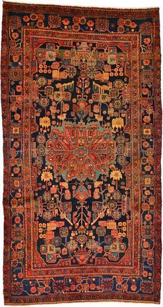 This Semi-Antique Authentic Persian Nahavand rug is Hand Knotted in Iran of 100% Natural Wool and has 150 knots per square inch.