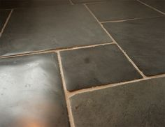 Black stone flooring - do this in the kitchen perhaps?
