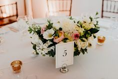 June centerpiece grown and designed by Love 'n Fresh Flowers. Blush, white and gold.