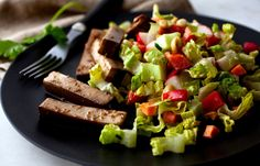 """Served with baked tofu """"fingers,"""" this salad can hold all the leftover vegetables from your Thanksgiving feast."""