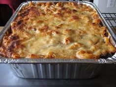 Use this recipe to make this delicious layered baked ziti casserole with ground beef, Italian sausage and three kinds of cheese.