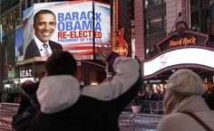 Times Square billboards broadcast Barack Obama projected to win the U.S presidential election