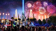 Star Wars characters are projected onto the sides of buildings as fireworks light up the night sky.