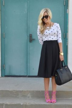white dotted shirt and black skirt
