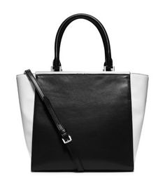 Meet your new go-to accessory on days that call for a little extra polish. We designed our Lana tote in a timeless architectural shape, crafted in smooth leather with a color-block palette and minimalist hardware. Carry it with all your 9-to-5 ensembles, or wear it as a statement accessory for nights out.
