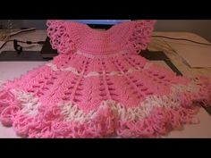In this video you will learn how to crochet this beautiful baby dress.  This dress features shells and posts stitches, lacy edge created using the solomons knot.  This dress can be made using hook sizes E - J.  Just be sure to use yarn weight appropriate to your hook.  This dress is great for special occasions or can be made using cotton yarn fo...