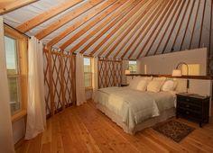 www.shelterdesigns.net  Cozy bedroom in a 30' Shelter Designs yurt.