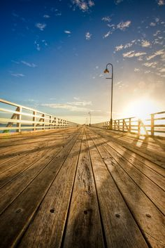 The sun peeks over Shorncliffe Pier, Brisbane, Australia.