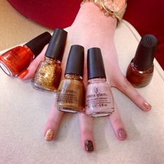 """""""Hunger Games"""" nail polish! Beauty Editor testing her favorite shades from the China Glaze """"Capitol Colours"""" collection.   Colors (left to right): Riveting, Electrify, Mahogany Magic, Dress Me Up, and Harvest Moon.  Available in March at Sally Beauty Supply, ULTA, and other specialty beauty retailers."""