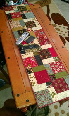 Disappearing nine patch table runner in Christmas-y colors