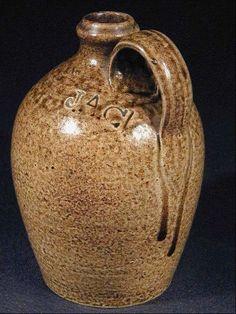 "Stoneware jug 6 3/4"" stoneware jug impressed JAC on the shoulder, the mark of John A. Craven, Randolph County, North Carolina, ca.1855. Sold on eBay by 36270215 for $2,175."