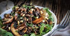 Mushroom salad with lentils and caramelized onions, topped with crunchy pine nuts and briny capers, it's a symphony of textures and fall flavors.