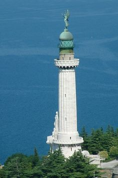 The Vittoria Lighthouse, Trieste, Italy.  Also known as the Victory Lighthouse, serving the Gulf of Trieste and located on the hill  off the Strada del Friuli.  At a height of 223 feet it is one of the tallest lighthouses in the world. The structure celebrates the Italian victory and commemorates the fallen of the first world war.