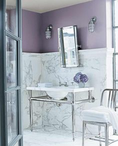 A glimpse of lilac brings out the rich veining in this bath's generous stonework for an overall sense of luxury. | Pendant RL2004, @ralphlauren Paint, available at @homedepot