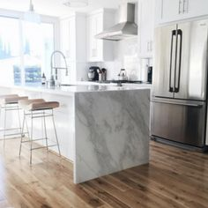 Wood floor with marble waterfall countertop