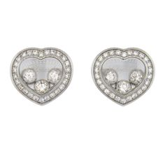 Brand new Chopard Icons 18K white gold heart bubble stud earrings featuring 0.16ctw of floating diamonds and 0.15ctw in the bezel (VVS/SI-F/G). Earrings measure 9.5mm x 10.2mm. Earrings are marked Cho