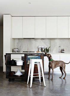 desire to inspire - sleek cabinets that stretch to the ceiling, but there's a reveal at the top.