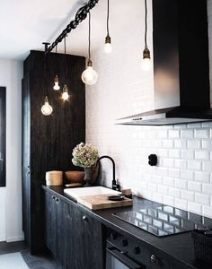 15 Modern Black & White Home Decor Ideas to Copy Black kitchen cabinets and appliances with white subway tiles Apartment Kitchen, Home Decor Kitchen, Diy Kitchen, Kitchen Interior, Kitchen Ideas, White Apartment, Kitchen Backsplash, Kitchen Wood, Kitchen Modern