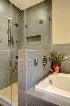 Small shower looks so much bigger with the glass wall!