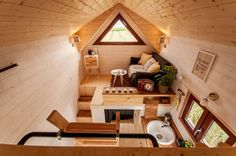 This beautiful house on wheels may look tiny, but it can easily fit a family of three thanks to its space-saving interior design. French tiny house company Baluchon designed the ultimate home for wandering minimalists, giving it a fitting name . Best Tiny House, Modern Tiny House, Tiny House Living, Tiny House Plans, Tiny House Design, Tiny House On Wheels, Living Room, Tiny House Cabin, Tiny House Movement