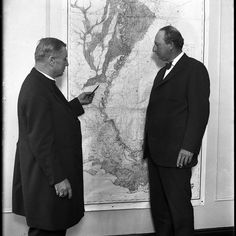 "Cornelius Van de Ven left the Roman Catholic bishop of the Diocese of Alexandria La. and Sen. Pat Harrison of Mississippi right pose next to a flood map of the Mississippi River in 1927. The two men were part of a flood control conference hosted by Chicago's Mayor William Hale Thompson to discuss the Great Flood of 1927 at the Hotel Sherman on June 2 1927. The Tribune reported ""The purposes of the gathering are to obtain future control of the Mississippi by the efforts of the federal…"