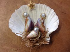This Seashell Manger Scene Christmas NativityOrnament is sure to be a favorite. This handmade Nativity Manger Scene Ornament was made here at Sea Things in V