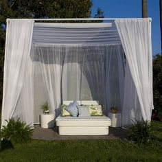A simple PVC frame with outdoor sheers creates an inviting pool cabana.  Could be a great DIY idea.