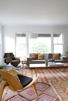 Love the layered rugs, not matchy but they are all friendly together