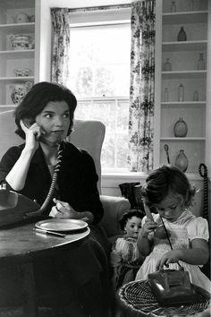 Jackie and Caroline Kennedy on the phone, 1960.