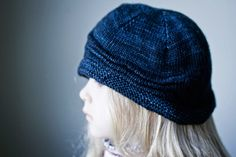 A hat knit in prussian blue. The light of the camera makes this look slightly brighter, but the colour is very very similar to the real thing.