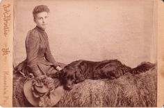 Vintage cabinet card photograph of a woman and her black Labrador Retriever, Honesdale, Pennsylvania.
