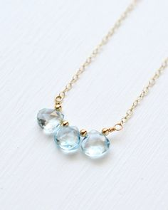 ITEM DETAILS Length: Choose 16, 18, or 20 inches Sky blue topaz: ~ 7 mm Clasp: lobster Chain: flat cable Metal: gold fill OR sterling silver This necklace features a trio of small faceted sky blue topaz briolettes suspended from a gold filled chain. Lobster clasp closure. This item can